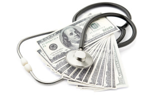 Stethoscope and money symbol for health care costs