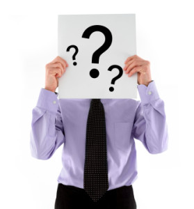 man asking holding question mark